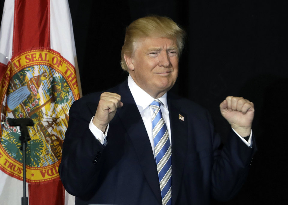 Republican presidential candidate Donald Trump pumps his fist after a campaign speech, Monday, Nov. 7, 2016, in Sarasota, Fla. (AP Photo/Chris O'Meara)